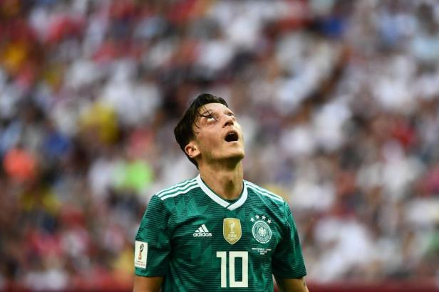 Ozil in action for Germany's ill-fated defence of the World Cup