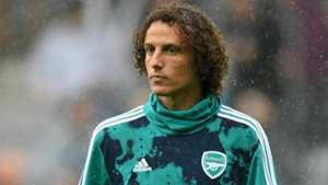 David Luiz signs